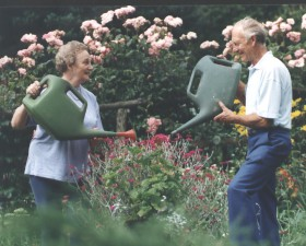 Nancy & Andrew watering cans by Graham McGirk